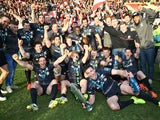 Saracens celebrate with the trophy after a last minute victory over Exeter in the LV= Cup Final on March 22, 2015