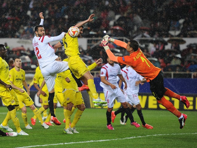 Sergio Asenjo Of Villarreal Fists The Ball Away From Vicente Iborra Of Fc Sevilla During The