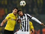 Dortmund's Greek defender Sokratis (L) and Juventus' Spanish forward Alvaro Morata vie for the ball during the Round of 16, second-leg UEFA Champions League football match  on March 18, 2015
