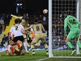 Sol Bamba of Leeds United (C) scores their second goal past goalkeeper Marcus Bettinelli of Fulham during the Sky Bet Championship match on March 18, 2015