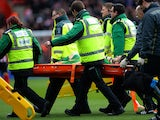 Fraser Forster of Southampton is stretched off the pitch after picking up an injury during the Barclays Premier League match between Southampton and Burnley at St Mary's Stadium on March 21, 2015