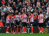 Southampton players celebrate after Jason Shackell of Burnley scored an own goal during the Barclays Premier League match between Southampton and Burnley at St Mary's Stadium on March 21, 2015