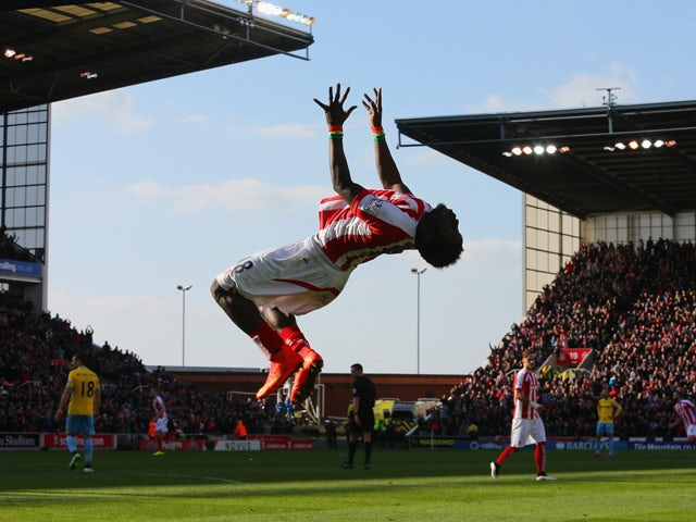 Mame Biram Diouf of Stoke City celebrates scoring the opening goal during the Barclays Premier League match between Stoke City and Crystal Palace at Britannia Stadium on March 21, 2015
