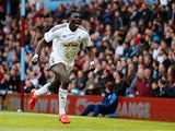 Bafetibis Gomis of Swansea City celebrates scoring the winning goal during the Barclays Premier League match between Aston Villa and Swansea City at Villa Park on March 21, 2015