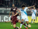Emiliano Moretti of Torino FC competes for the ball with Axel Witsel of FC Zenit during the UEFA Europa League Round of 16 match between Torino FC and FC Zenit on March 19, 2015