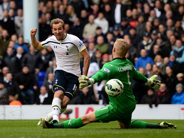 Harry Kane of Spurs shoots at goal past Kasper Schmeichel of Leicester City during the Barclays Premier League match between Tottenham Hotspur and Leicester City at White Hart Lane on March 21, 2015