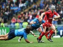 Jonathan Davies of Wales breaks past Leonardo Ghiraldini and Martin Castrogiovanni of Italy during the RBS 6 Nations match between Italy and Wales at Stadio Olimpico on March 21, 2015