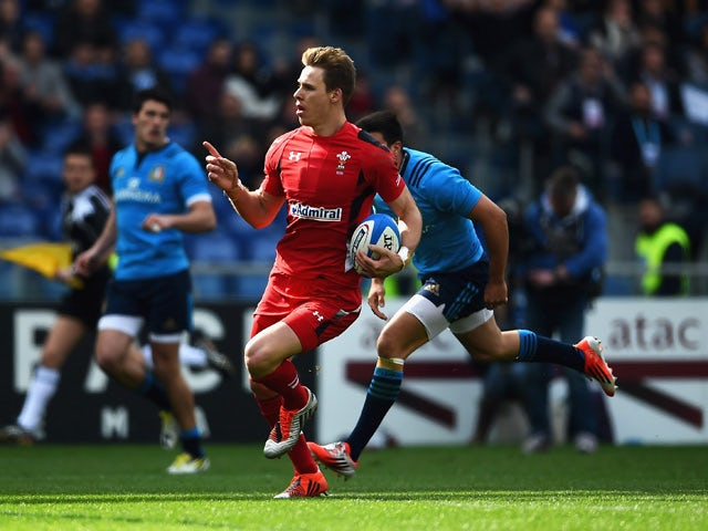 Liam Williams of Wales celebrates scoring his try during the RBS 6 Nations match between Italy and Wales at Stadio Olimpico on March 21, 2015