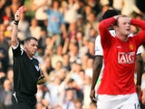 Manchester United's Wayne Rooney is sent off by referee Phil Dowd for receiving a second yellow card during the Premier League football match between Fulham and Manchester United at Craven Cottage in London, on March 21, 2009