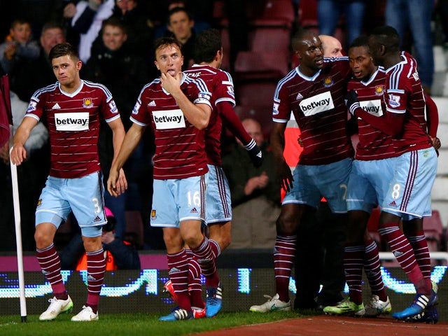 Diafra Sakho of West Ham celebrates with team-mates after scoring the winning goal during the Barclays Premier League match between West Ham United and Sunderland at Boleyn Ground on March 21, 2015