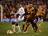 Tom Ince of Derby is challenged by Nouha Dicko of Wolves during the Sky Bet Championship match between Wolverhampton Wanderers and Derby County at Molineux on March 20, 2015