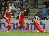 Wales' midfielder Aaron Ramsey (R) points to the sky in celebration of his goal during the Euro 2016 qualifying football match between Israel and Wales at the Sammy Ofer Stadium in the Israeli coastal city of Haifa, on March 28, 2015