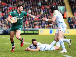 Adam Thompstone of Leicester Tigers is tackled by Phil Dollman and Matt Jess of Exeter Chiefs during the Aviva Premiership match between Leicester Tigers and Exeter Chiefs at Welford Road on March 28, 2015