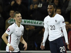 France's forward Alexandre Lacazette (R) celebrates next to midfielder Morgan Schneiderlin after scoring a goal during a friendly football match between France and Denmark at the Geoffroy-Guichard stadium in Saint-Etienne on March 29, 2015
