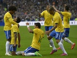 Brazil's midfielder Luiz Gustavo is congratulated by teammates after scoring a goal during the friendly football match France vs Brazil, on March 26, 2015