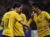 Brazil's forward Oscar is congratulated by teammates after scoring a goal during the friendly football match France vs Brazil, on March 26, 2015