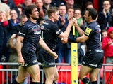 Chris Ashton (C) of Saracens is congratulated by teammate Neil de Kock (R) of Saracens after scoring his team's second try during the Aviva Premiership match between Saracens and Harlequins at Wembley Stadium on March 28, 2015