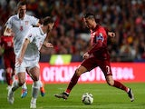 Portugal's forward Cristiano Ronaldo (R) controls the ball near Serbian defender Branislav Ivanovic (C) and midfielder Aleksandar Mitrovic during the Portugal vs Serbia EURO 2016 qualifying football match at Luz stadium in Lisbon on March 29, 2015