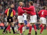 David Beckham (left) celebrates with Steve McManaman (right) of England after the World Cup 2002 Group 9 Qualifying match against Finland at Anfield on March 24, 2001
