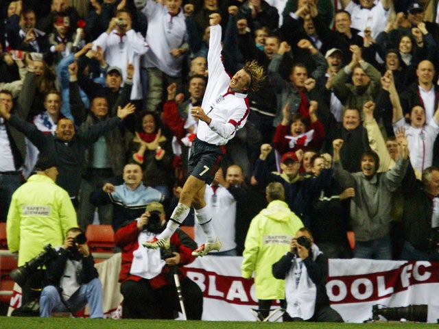 David Beckham of England celebrates in front of the England fans during the UEFA Euro 2004 Qualifying match between England and Turkey held on April 2, 2003