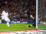 Raheem Sterling of England scores the third goal during the EURO 2016 Qualifier match between England and Lithuania at Wembley Stadium on March 27, 2015
