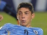 Federico Valverde (R) of Uruguay in action against Ecuador in the U-17 South American final round football match at Feliciano Caceres Stadiun in Luque, Paraguay on March 17, 2015