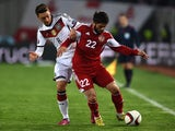 Georgia's Giorgi Navalovski (R) and Germany's midfielder Mesut Ozil vie for the ball during the Euro 2016 qualifying football match between Georgia and Germany at the Boris-Paitschadse-Stadium in Tbilisi , Georgia on March 29, 2015