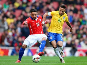 Gonzalo Jara of Chile and Neymar of Brazil comnpete for the ball during the international friendly match between Brazil and Chile at the Emirates Stadium on March 29, 2015