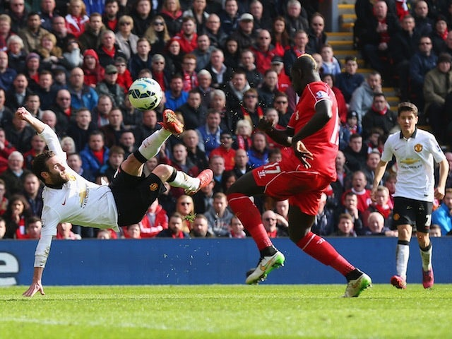 Juan Mata of Manchester United scores his second goal during the Barclays Premier League match against Liverpool at Anfield on March 22, 2015