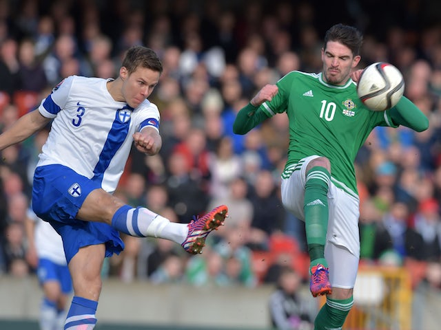 Kyle Lafferty (R) of Northern Ireland and Niklas Moisander (L) of Finland in action during the EURO 2016 Group F qualifier at Windsor Park on March 29, 2015
