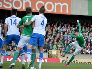 Kyle Lafferty of Northern Ireland scores during the EURO 2016 Group F qualifier at Windsor Park on March 29, 2015