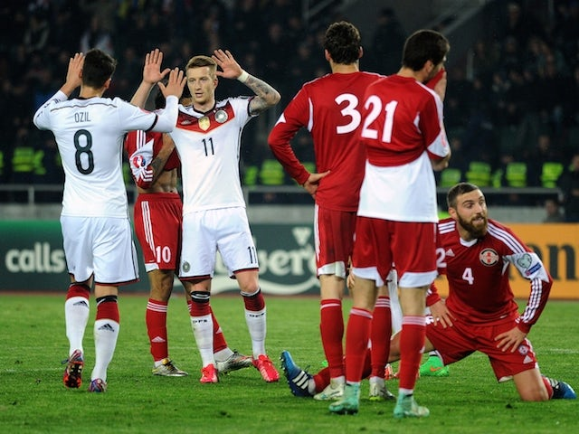 Germany's midfielder Mesut Ozil and Germany's midfielder Marco Reus celebrate their team's second goal during the Euro 2016 qualifying football match between Georgia and Germany in Tbilisi on March 29, 2015