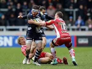 Mark Cueto of Sale Sharks is tackled by Brendan Macken of Gloucester during the Aviva Premiership rugby match between Sale Sharks and Gloucester Rugby at AJ Bell Stadium on March 29, 2015