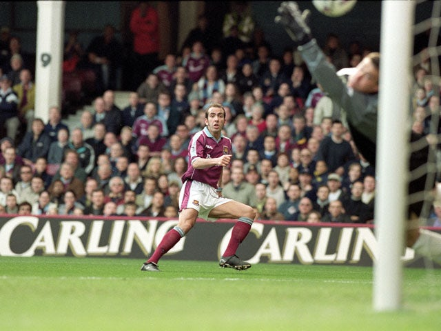 Paolo Di Canio scores the first goal for West Ham United during the FA Carling Premiership match against Wimbledon at Upton Park in London March 26, 2000