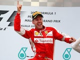Ferrari's Sebastian Vettel celebrates on the podium after winning the Malaysian Grand Prix on March 29, 2015