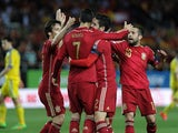 Spain's forward Alvaro Morata celebrates after scoring a goal with Spain's midfielder Isco, Spain's forward David Silva and Spain's defender Jordi Alba (R), during the EURO 2016 qualifier football match Spain vs Ukraine at the Ramon Sanchez Pizjuan stadiu