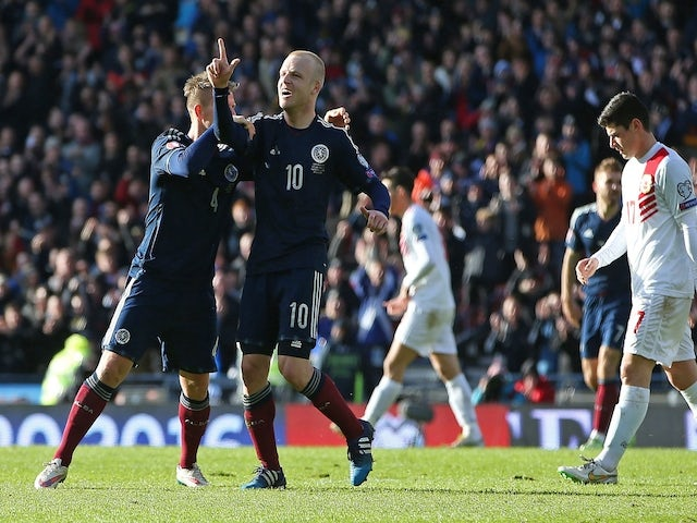 Scotland's striker Steven Naismith (2nd L) celebrates after scoring their fourth goal during the Euro 2016 qualifying football match between Scotland and Gibraltar at Hampden Park in Glasgow, Scotland on March 29, 2015