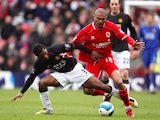 Afonso Alves of Middlesbrough is challenged by Patrice Evra of Manchester United during the Barclays Premier League match between Middlesbrough and Manchester United at the Riverside Stadium on April 6, 2008