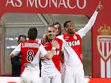 French forward Anthony Martial (R) celebrates after scoring a goal during the French L1 football match between Monaco and Saint Etienne on April 3, 2015