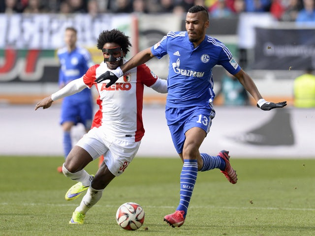 Augsburg's Brazil midfielder Caiuby and Schalke's Cameroon striker Eric Maxim Choupo-Moting vie for the ball during the German first division Bundesliga football match FC Augsburg vs FC Schalke 04 in Augsburg, southern Germany, on April 5, 2015