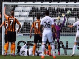 Swansea City's French striker Bafetimbi Gomis (3rd L) scores their second goal past Hull City's Scottish goalkeeper Allan McGregor (2nd R) during the English Premier League football match between Swansea City and Hull City at The Liberty Stadium in Swanse