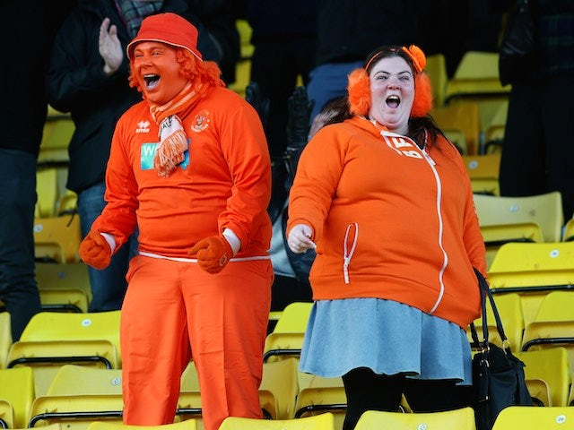 Blackpool fans celebrate the team's second goal during the Sky Bet Championship match against Watford at Vicarage Road on January 24, 2015