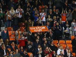 Blackpool match abandoned after pitch invasion