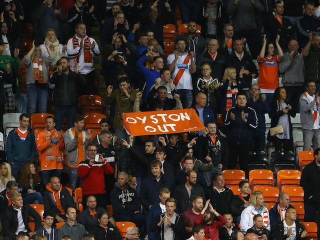 Supporters of Blackpool protest against chairman Karl Oyston at the beginning of the second half during the Sky Bet Championship match between against Cardiff City at Bloomfield Road on October 3, 2014