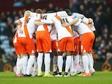 Blackpool players huddle during the FA Cup Third Round match against Aston Villa at Villa Park on January 4, 2015