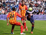 Bordeaux's Senegalese forward Henri Saivet vies with Lens' French defender Ludovic Baal during the French L1 football match between Girondins de Bordeaux (FCGB) and Lens (RCL) on April 5, 2015