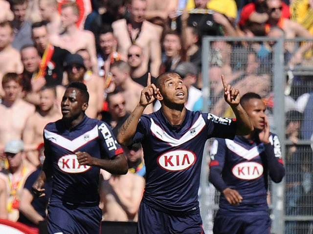 Bordeaux's Brazilian defender Mariano celebrates after scoring a goal during the French L1 football match between Girondins de Bordeaux (FCGB) and Lens (RCL) on April 5, 2015
