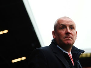 Mark Warburton the Brentford manager looks on before the Sky Bet Championship match between Fulham and Brentford at Craven Cottage on April 3, 2015