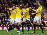 Stuart Dallas of Brentford celebates with team mates after opening the scoring during the Sky Bet Championship match between Fulham and Brentford at Craven Cottage on April 3, 2015