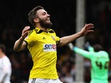 Stuart Dallas of Brentford celebates scoring his second goal during the Sky Bet Championship match between Fulham and Brentford at Craven Cottage on April 3, 2015